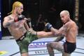 Sean O'Malley kicks Marlon Vera in their bantamweight bout during UFC 252. Photo: Jeff Bottari/Zuffa LLC