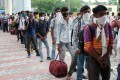 Migrant workers arriving from neighbouring states queue for Covid-19 testing in New Delhi. Photo: Bloomberg