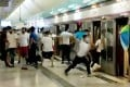 Screen capture from a video showing a number of people in white T-shirts carrying wooden sticks chasing and assaulting passengers arriving at Yuen Long station. Photo: SCMP