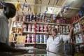 Jay Shree, a businessman of Asian origin, serves a customer in his store in Kampala, Uganda. Photo: Reuters