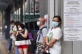 People queue up to collect virus test pack at the West Kowloon Health Centre, Sham Shui Po. Photo: Sam Tsang