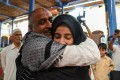 Mohammed Ali Bhat hugs a relative after his release from prison in 2019. Photo: Getty Images