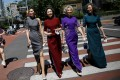 Four famous amateur model grandmothers took off their masks and walked down a street in Beijing to celebrate life returning to normal as the Covid-19 pandemic eases. Photo: Reuters