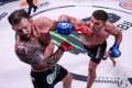 Vadim Nemkov lands a punch on Ryan Bader at Bellator 244. Photos: Bellator MMA