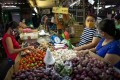 Vendors chat at a public market in Rizal province, in the Philippines. Government relief programmes have assisted those who temporarily lost their livelihoods because of the Covid-19 lockdowns. Photo: Reuters