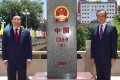 Vietnamese Deputy Prime Minister Pham Binh Minh (left) and Chinese Foreign Minister Wang Yi commemorate the 20th anniversary of the demarcation of their countries' land boundary and the 10th anniversary of the erection of boundary markers. Photo: Xinhua