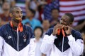 Team USA's Kobe Bryant and Dwyane Wade bite their gold medals on the podium after at the Beijing 2008 Olympic Games. Photo: AFP