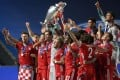 Bayern Munich players celebrate with the trophy after the Uefa Champions League final win over Paris Saint-Germain in Lisbon. Photo: AFP