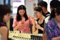"""""""The sheer size of China's female consumer population makes it the third-largest consumer market in the world"""". Photo: Xinhua"""