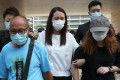 From left, Chan Yin-lam's grandfather, Ho Yun-loi; mother Ho Pui-yee; and cousin Chan Tsz-Kwan arrive for the beginning of an inquest into her death on Monday. Photo: K. Y. Cheng