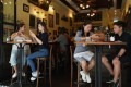Customers having lunch at a restaurant in Hong Kong's Central neighbourhood in May. Covid-19 health restrictions have become so tiresome for individuals that even a slight easing is welcome. Photo: Xiaomei Chen
