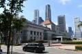 The national flag of Singapore flies on the roof of Parliament House in this file photo. Photo: AFP