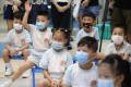 Young students back in class in Shau Kei Wan on June 15, during a phased reopening of schools after they remained mostly shut since the Lunar New Year because of a Covid-19 outbreak. The third wave has brought an indefinite ban on face-to-face teaching. Photo: Nora Tam