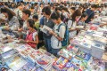 Readers attend the 30th Hong Kong Book Fair at the Hong Kong Convention and Exhibition Centre in Wan Chai in July 2019. Photo: Nora Tam