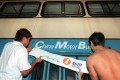 A New World logo replaces a China Motor Bus logo on the side of a bus in 1998. This month New World First Bus, as CMB became, was sold again, along with Citybus, to private equity buyers. Photo: SCMP
