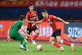 Oscar of Shanghai SIPG breaks through against Beijing Guoan in the 2020 Chinese Super League season. Dan O'Hagan commentated on the game live in an English-language broadcast shown around the world. Photo: Xinhua