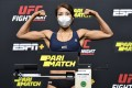 Kim Ji-yeon Kim of South Korea poses on the scale during the UFC Fight Night weigh-in at UFC Apex on August 28, 2020 in Las Vegas, Nevada. Photos: Jeff Bottari/Zuffa LLC