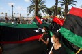 Demonstrators march during an anti-government protest in Tripoli, Libya. Photo: Reuters