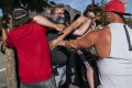 A Black Lives Matter protester scuffles with attendees of a pro-Trump rally during in Oregon on Saturday. Photo: AFP