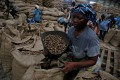 Women work at a cashew warehouse in Abidjan, Ivory Coast. The nut crisis has been compounded by bumper crops worldwide, and a wide range of idiosyncratic local challenges. Photo: Reuters