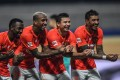 Guangzhou Evergrande's Fernandinho, Anderson Talisca, Elkeson and Paulinho celebrate a goal in their win over Shanghai Shenhua. Photo: Xinhua