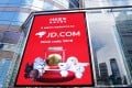 A screen showing the listing of JD.com in Hong Kong outside the trading hall of Hong Kong Exchanges and Clearing on June 18. Photo: Xinhua