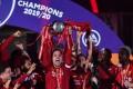 Liverpool's Jordan Henderson lifts the English Premier League trophy but who will win the Fantasy Premier League? Photo: Reuters