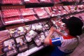 Packaged meat at a supermarket in Taipei. President Tsai Ing-wen has announced that Taiwan will ease restrictions on importing US pork and beef from cattle over 30 months old to promote Taiwan-US trade ties. Washington has repeatedly urged Taiwan to lift pork and beef restrictions, calling it the main obstacle to signing a Taiwan-US free-trade pact. Photo: EPA-EFE