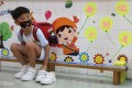 A child changes his shoes before heading into the classroom at a kindergarten in Shau Kei Wan on June 15. Photo: Nora Tam