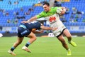 Jordan Rapana, right, of the Canberra Raiders in action, wearing the club's jersey featuring main sponsor Huawei Technologies at the CBus Super Stadium in Robina, a suburb in the city of Gold Coast, in Queensland, Australia, on August 22. Photo: EPA-EFE