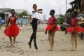 Ballet student Anthony Mmesoma Madu dances in the street as fellow dancers look on in Lagos, Nigeria. After a video of him dancing went viral, Anthony earned a scholarship from the prestigious American Ballet Theatre in New York. Photo: AP