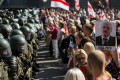 Belarusian servicemen block a street during a protest against disputed presidential election results in Minsk. Photo: AFP