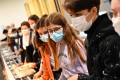 Pupils wearing protective masks queue at the cafeteria in Brequigny high school in Rennes. Photo: AFP