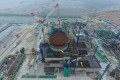 A containment dome is installed at the Fuqing Nuclear Power Plant in Fujian province in 2017. After more than a year without approving any nuclear projects, China is again turning to the controversial technology. Photo: Xinhua