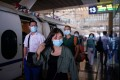 People arrive at Wuhan railway station on Wednesday. The new virus was first reported in the central Chinese city late last year. Photo: Reuters