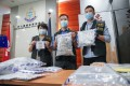 Officers (from left) Lam Yuen-ling, Alan Chung, and Chan Yuen-fun, with some of the evidence seized during the operation in Tsuen Wan. Photo: Winson Wong
