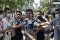 Pro-democracy activist and human rights lawyer Arnon Nampha, centre, speaks as he arrives at a courthouse in Bangkok on Thursday. Photo: AP