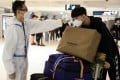 Sunny Gu, an international student from China, arrives at Sydney International Airport. Photo: Reuters