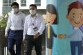 Pedestrians walk past a mural in the Central district of Hong Kong during a coronavirus disease outbreak in the city, on July 20. Photo: handout