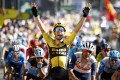 Belgian cyclist Wout Van Aert of Team Jumbo-Visma celebrates as he crosses the finish line to win the seventh stage of the Tour de France. Photo: DPA