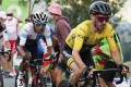 Mitchelton-Scott rider Adam Yates of Britain, wearing the overall leader's yellow jersey, and Team INEOS Grenadiers rider Egan Bernal of Colombia, wearing the white jersey for best young rider, in action. Photo: Reuters