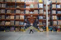 Workers in a TMall.com warehouse in Jiangmen, Guangdong Province. Photo: EPA-EFE