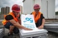 Workers place a China Mobile 5G sign as they install a 5G network base station in Fenggang, Guizhou province, China on May 26, 2020. Photo: Reuters