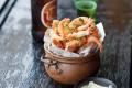 Chilli salted school prawns with garlic prawns from Luke Nguyen's cookbook, Indochine. Photo: Handout