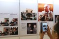 A visitor takes a picture during the opening ceremony of an exhibition dedicated to Deng Xiaoping, at the Hong Kong Convention and Exhibition Centre in Wan Chai on August 21, 2014. Photo: Sam Tsang