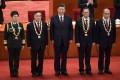 (From left) Major General Chen Wei, Zhang Boli, President Xi Jinping, Zhong Nanshan and Zhang Dingyu during the ceremony in Beijing on Tuesday. Photo: AFP