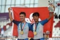 Leung Chun-wing (left) and Cheung King-lok celebrate after capturing a men's madison gold medal for Hong Kong at the 2018 Asian Games in Jakarta. Photo: AFP