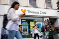 Pedestrians are pictured walking past a branch of a Thomas Cook travel agent's shop in London in September 2019 before it went into administration. Photo: AFP
