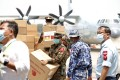 Myanmar soldiers carry medical aid provided by China at the Yangon International Airport. Photo: EPA