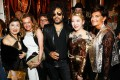 Rock star Lenny Kravitz to the right of Baccarat owner Coco Chu and its ex-CEO Daniela Riccardi at the Baccarat Goldfinger party in Paris on September 8, 2017. Photo: Getty Images